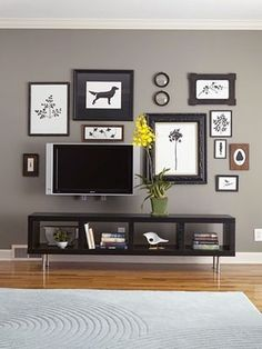 benjamin moore asphalt. Love the color and love the offset tv with pictures. I'd do that in my bedroom, or formal living room (if I ever have one).