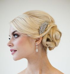Wedding Hair Accessory, Rhinestone Feather Haircomb, Brooch Style Hair Comb. $49.00, via Etsy.