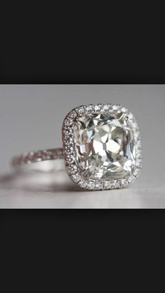 This is it :) cushion cut halo. Beautiful. It looks flush against the setting instead of raised up which looks so nice