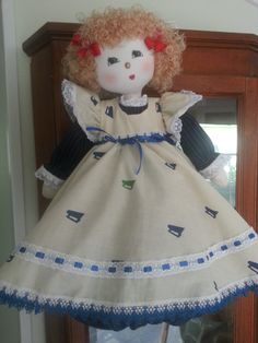 """This is """"Niki"""". Hand made plastic bag holder doll, made in Costa Rica. She has strawberry blond hair, her dress is blue pin stripe and beige print gingham."""