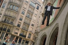 Bilbao, Spain: The Geman street artist Johan Lorbeer performs Tarzan: Standing Leg Still Life Performance, at the Alhondiga Centre on the first day of Aste Nagusia, a nine-day fiesta