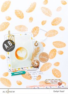 Fall color combo + perfect stamp + photo of coffee = perfect! The pattern of the leaves makes this layout look very fall-like. To know more about this card, visit our blog.  http://altenewblog.com/2016/11/28/fall-color-combosimple-flower-stamp-set-perfect/  Altenew Website: https://altenew.com/