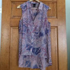 Button-up high to low tank Beautiful collared tank top!! Button-up, very light weight chiffon, light pink and violet paisley design. It's longer in the back. H&M Tops Button Down Shirts
