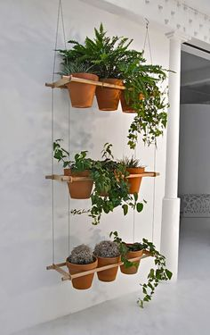 I LOVE this idea for some of the plants on the front porch...how hard could it be to make?