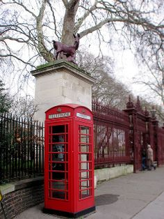 The Queen's Gate of Hyde Park, London. The red phone booths, quintessential London! Great memories in that town.