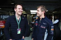 Actor Michael Fassbender talks with Sebastian Vettel of Germany and Infiniti Red Bull Racing following the qualifying session for the Canadian Formula One Grand Prix at the Circuit Gilles Villeneuve on June 8, 2013 in Montreal, Canada.