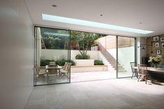 Minimal windows as modern patio doors in London by IQ Glass.