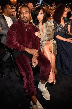 Kanye West & Kim Kardashian West pose in the front row at the 2015 Grammys.