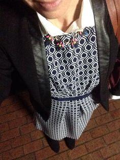 Blue white pattern dress, white button up, tights black pumps, black blazer, bright necklace