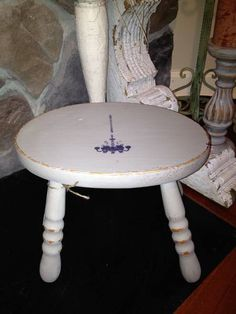 Adorable stool with chandelier accent.