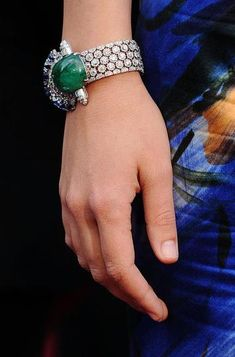Jewelry is all about making a statement! Check out Maggie Gyllenhaal's gem-filled statement bracelet. Her 1920s platinum and diamond bracelet featuring a gorgeous cabochon emerald, and sapphires is simply beautiful!
