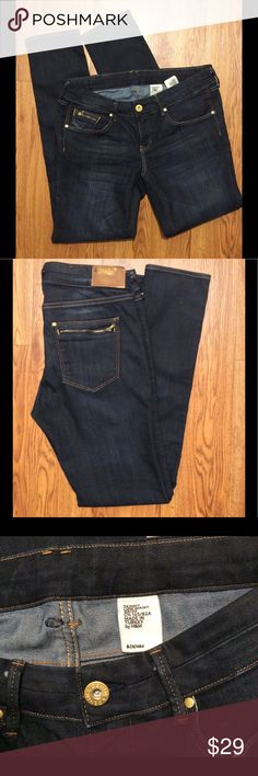 H&M Dark Skinny Jeans with Gold Button Great condition, low waist, 29-inch inseam, label reads 32/32, but these fit like a 28 or 29, gold zippers and buttons, 44% cotton, 30% lyocell, 26% elastin H&M Jeans Skinny