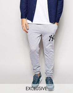 """Sweatpants by Majestic Jersey material Stretch waistband Side pockets Large logo design to thigh Single pocket to rear Ankle cuffs Regular fit Machine wash 65% Polyester, 35% Cotton Our model wears a size Medium and is 188 cm/6'2"""" tall"""