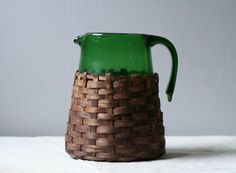wicker wrapped green glass pitcher