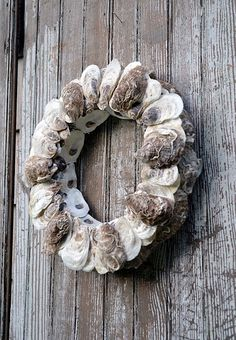 DIY Oyster Shell Wreath. Quite similar to the seashell wreath I made my sister two years ago.