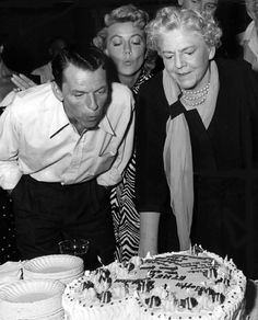 "Frank Sinatra and Dorothy Malone help Ethel Barrymore  blow out the candles on her birthday cake on the set of ""Young at Heart"" (1954)"