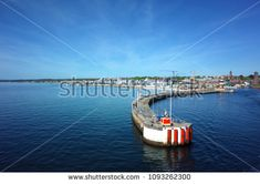 Helsingborg, Sweden - 06 May, 2018: View over city coast line and harbor parapet from ferry arriving to Helsingborg