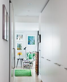 Architect Anne-Marie Fleming extended this hallway to get the necessary length for a row of closets that leads into the bedroom, essentially turning the hall into a walk-in closet.