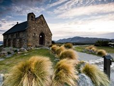 """Church of the Good Shepherd, South Island An old stone church sits among the placid grasses of New Zealand's South Island, a land known for its wide expanses of untouched land and vast farming outlets. Aotearoa, or """"the long white cloud,"""" was the first name given to New Zealand when the Maoris arrived on its inlet shores centuries before European explorers sailed through the Pacific waters. Within the compact island nation there are alps to rival Switzerland's, plains more fruitful than…"""
