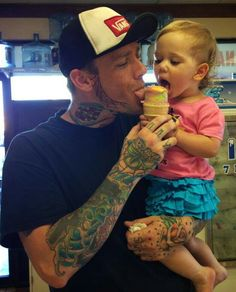 Sharing a yummy cone with her favorite guy....