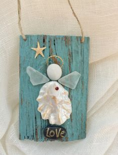 A personal favorite from my Etsy shop https://www.etsy.com/listing/576367005/beachcomber-angel
