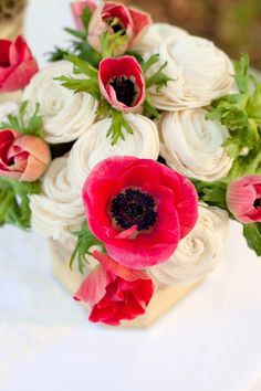Amazing pink and white flower arrangement featuring the black eyed anemone flower. #flowers
