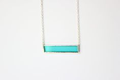 Teal glass with nickle-free, sterling silver chain in a lead-free solder.  Chain…