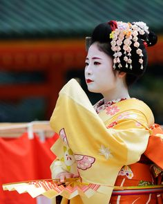 Spring dances at the Heian Shrine with maiko Shino by Tamayura on FlickrShino is a second-year maiko, so she has yet 2-3 more years to complete her training and become a geiko.