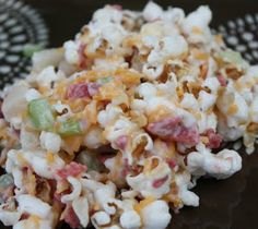 POPCORN SALAD!   6 cups popped corn  1 c. diced celery  1/2 c. diced water chestnuts  3/4 cup fried & drained bacon, be sure its crisp  1/2 cup green onion, chopped  3/4 c. mayonnaise (not lite)  1 cup shredded cheddar cheese