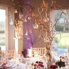 This is such a pretty wedding, so many amazing decorations ideas, fairy lights, twigs and glass baubles. beautiful!