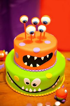 Monster themed birthday party with a colorful monster cake, plush dolls, layered jello, fuzzy headbands, lollipops and lots more goodies!