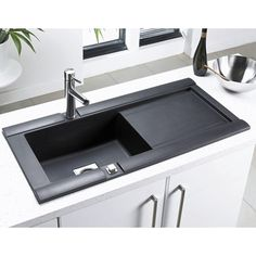 This black granite sink will stand out perfectly in any kitchen with any design and colour scheme! #kitchensinks