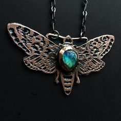 Hey, I found this really awesome Etsy listing at https://www.etsy.com/listing/473053657/moth-necklace-with-labradorite-copper
