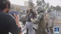 WATCH: Students protesting uni debts violently water cannoned by police in Santiago