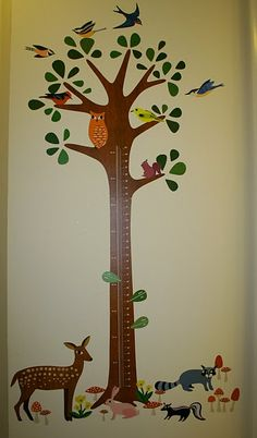 Measuring tree - cute in a baby/kid room with a forest theme.