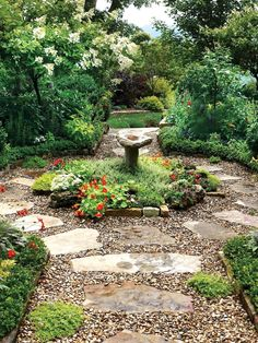 Hard landscaping ideas for a cottage garden pottager front garden - Large flagstone pavers, surrounded by pea gravel, create a rustic, winding path in this lush backyard that's filled with blooming perennials and ornamental trees. Unique Garden, Diy Garden, Garden Cottage, Shade Garden, Backyard Cottage, Cacti Garden, Natural Garden, Herb Garden, Garden Beds