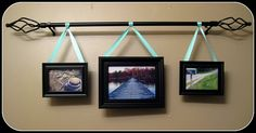photos on a curtain rod