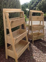 Raised wooden planter box.  Great for herbs/greens beside the kitchen.