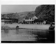 "White's Point Hot Springs  (also known as ""White Point"") two-story hotel (left) and  restaurant (right), with Rámon Sepúlveda (b. 1854), son of José Diego  Sepúlveda, on horseback near shore in foreground."