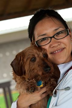 One of our students holds her dog before being examined