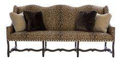 """DOMINIQUE SOFA No: 501-030-030-COM  84-1/2"""" W x 32-1/2""""D x 41-1/2""""H  Camel back sofa with exposed carved wood leg and stretcher base in ebonized finish. Antiqued bronze nailhead trim. Includes four standard throw pillows with knife edge and self-welt.  COM requires 24 yards of plain fabric @ 54""""  Shown in Nakisa II AG-1039-AA with Almeria Tape 990-710-100."""