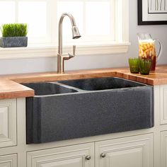 Buy the Signature Hardware 254135 Blue Gray Direct. Shop for the Signature Hardware 254135 Blue Gray Polished Granite Offset Double Basin Farmhouse Sink and save. Stone Kitchen, Farmhouse Sink Kitchen, New Kitchen, Kitchen Sinks, Granite Kitchen, Bistro Kitchen, Kitchen Shop, Granite Countertops, Vintage Kitchen