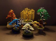 This is a large showpiece Wire Bonsai scene made up of ten different gold wire Bonsai trees on three towers of deadwood. Wire Bonsai tree sculpture made by Steve Bowen Wire Crafts, Metal Crafts, Bonsai Wire, Wire Tree Sculpture, Crystal Tree, Wire Trees, D House, Metal Tree, Fantastic Art