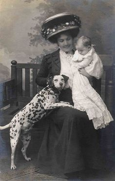 Stylish hat, baby and dalmation