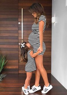 Include your oldest daughter in your pregnancy with these matching striped dresses. Striped maternity dress and little girl striped dress. I love mommy and me matching outfits! #affiliate #matchingdresses