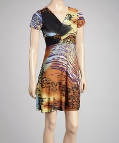 Take a look at this Brown & Gold Animal Surplice Dress by Avital on #zulily today!