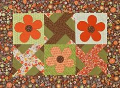 Alternate Windmill blocks and appliquéd flower blocks to create a quick and easy wall hanging quilt.