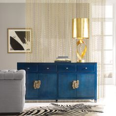 Rich colors and luxurious home accessories create a glamorous living room with imagination and fun