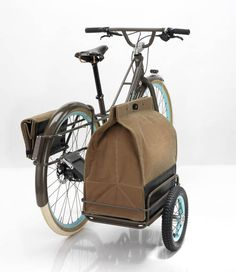"This bike, called The Fremont, has an interesting story. But really, I'm just charmed by its looks. The collapsible ""sidecar"" and canvas bag? Genius! It's fun just imagining what I might tote around in a bag like that."