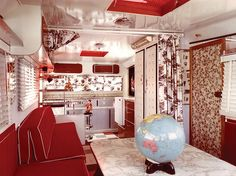 Holy kitsch! The interior of this 1964 Jackson Caravelle is 16 feet and 9 inches full of red marbly, patterned glamor. Photo courtesy: Bryan Jackson via Chris Hunter.